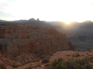 Looking forward from Skeleton Point as the sun peaked over the canyon horizo