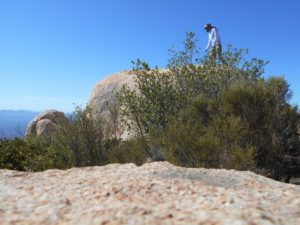Me, climbing around on some boulders on the summit for better views!