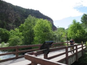My parents enjoying themselves on the bridge over Grizzly Creek in Glenwood Canyon
