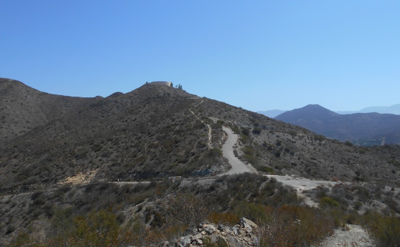 From the viewpoint, looking at the paved road; optional dirt trail is immediately to its left